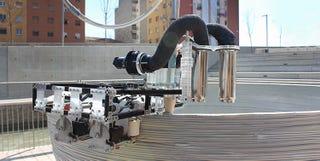 Illustration for article titled Un equipo de tres robots capaz de imprimir en 3D edificios enteros