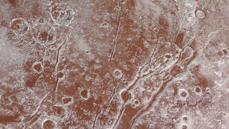 Illustration for article titled NASA's New Photos Bring Pluto's Surface Into Sharp Focus