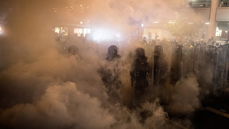 Riot police shrouded in gas on the streets of Hong Kong on July 21, 2019.