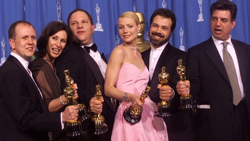 Harvey Weinstein, third from left, with one of his accusers Gwyneth Paltrow at the Academy Awards. Image via the AP.
