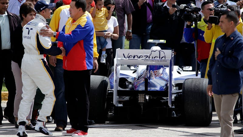 The late Venezuelan president Hugo Chavez getting chummy with his state-supported F1 driver, Pastor Maldonado, in happier times of 2011. Photo Credit: AP