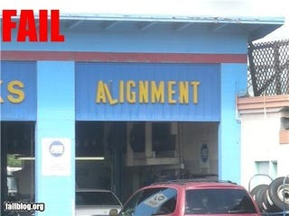 Illustration for article titled Auto Repair Shop Sign Alignment FAIL