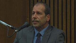 Theodore Wafer, 55, takes the stand in a Michigan courtroom Aug. 4, 2014, during his second-degree-murder trial for the fatal shooting of Renisha McBride.WXYZ Detroit screenshot