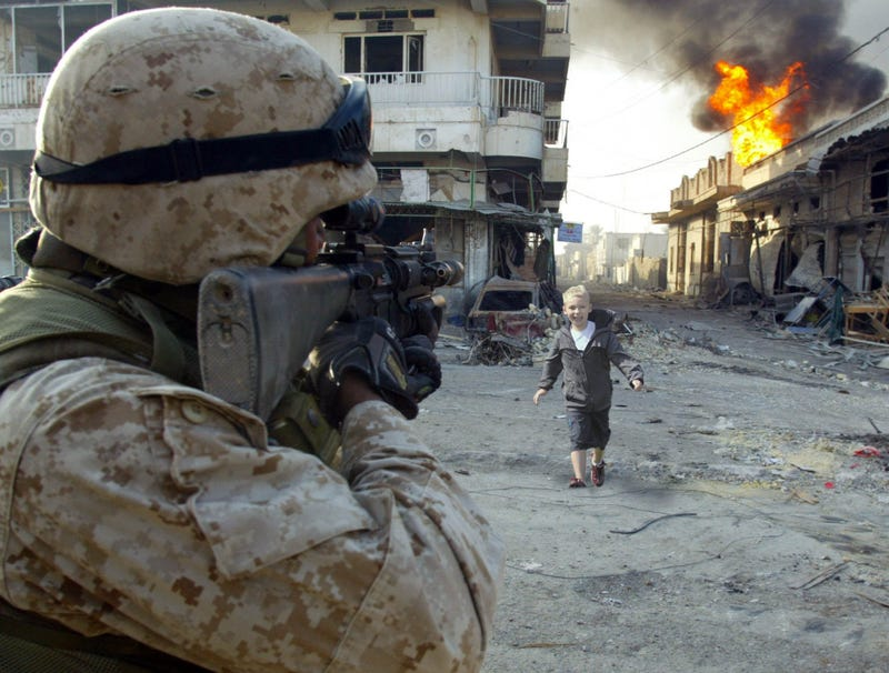 Illustration for article titled 8-Year-Old Boy Surprises Marine Dad During Firefight In Afghanistan