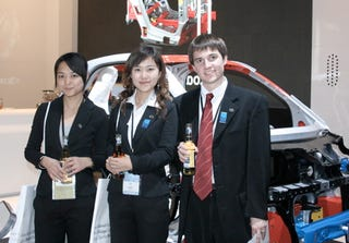 Illustration for article titled Detroit Auto Show: BYD's Young Exec Can Get Girls