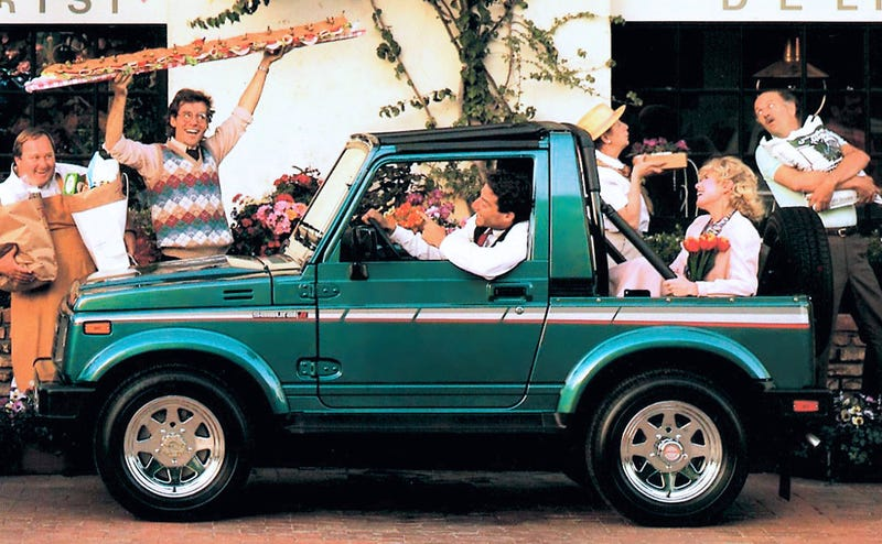 It's always a party in a tiny teal truck. Photo credit: Suzuki