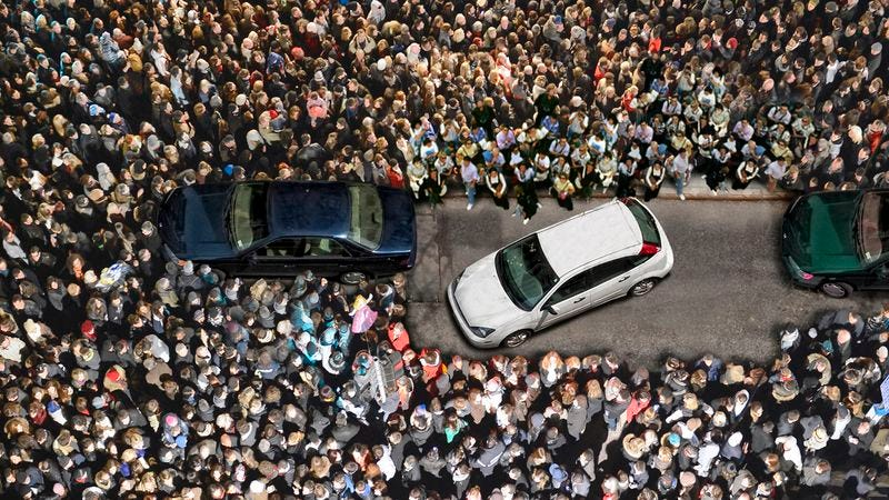 Illustration for article titled Nation Gathers Around Area Man Trying To Parallel Park