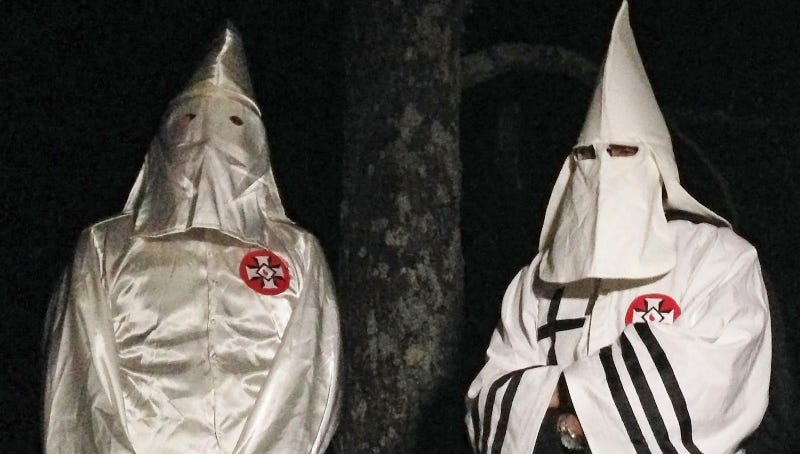 Two members of the Ku Klux Klan photographed in Pelham, North Carolina on December 2, 2016. Image via AP Photo.