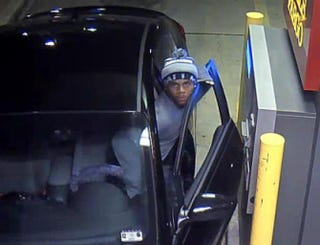 Screenshot of a suspect in a Jan. 14, 2015, drive-through ATM robbery and kidnapping in Arlington, Texas, from surveillance video YouTube