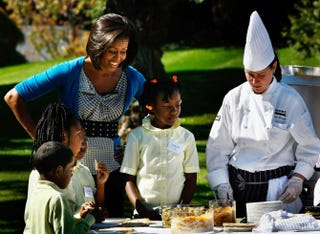 Michelle Obama works with students on preparing healthy meals.Win McNamee/Getty Images
