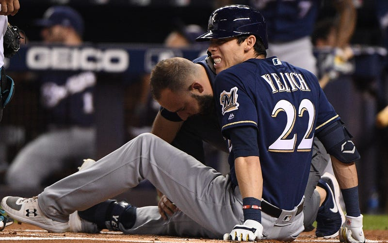 Illustration for article titled Christian Yelich Fractures Kneecap With Foul Ball, Is Done For The Season