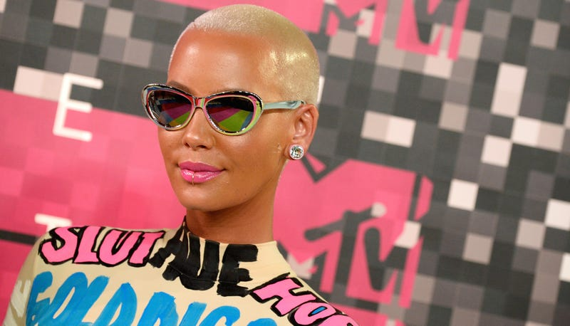 Illustration for article titled Amber Rose Is Pissed at GQ for 'Negative' Profile That References Kanye, Wiz Khalifa