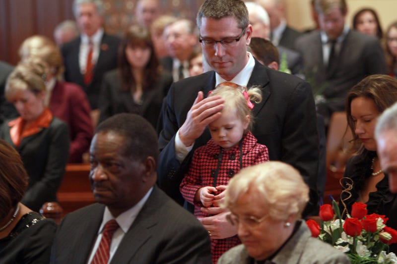 Then-state Sen. Michael Frerichs holds his 2-year-old daughter, Ella, during Senate Inauguration ceremony at the Capitol in Springfield, Ill., on Jan. 12, 2011.Michael Tercha/Chicago Tribune/MCT via Getty Images