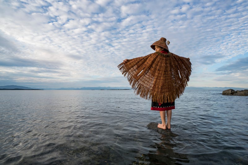 Ta'Kaiya Blaney, from the Tla'Amin First Nation in British Columbia, Canada, standing at the edge of the Salish Sea, where she grew up.