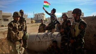 Kurdish Peshmerga fighters pose for a picture during a break in fighting against the Islamic State group on Nov. 8, 2014, in the besieged Syrian border town of Ain al-Arab.Ahmed Deeb/Getty Images