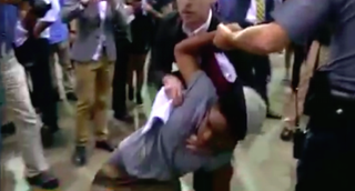 Protester struggles with security at Donald Trump rally in Richmond, Va., Oct. 14, 2015, after a fight breaks out.YouTube screenshot