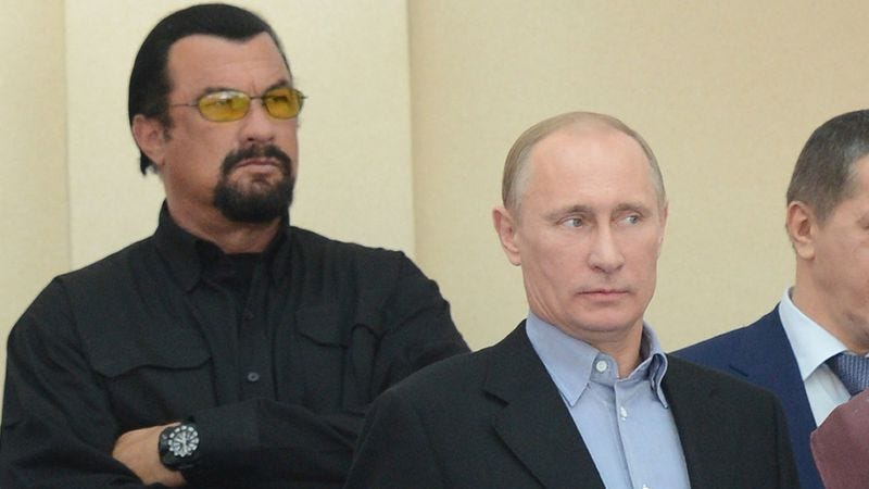 Steven Seagal, Vladimir Putin, and their fire down below.  (Photo by Dmitry Azarov / Kommersant via Getty Images)