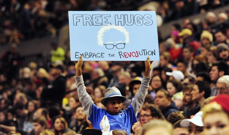 This photo taken March 25, 2016, shows Devonte Hart holding up a sign as then-Democratic presidential candidate Bernie Sanders spoke at a rally in Portland, Ore.