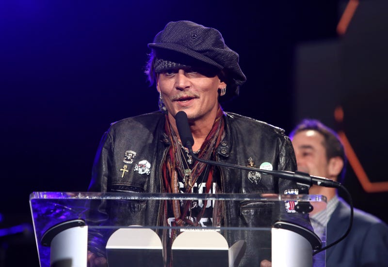 Yes, this is a recent photo of Johnny Depp.  (Jesse Grant/Getty Images for NAMM)
