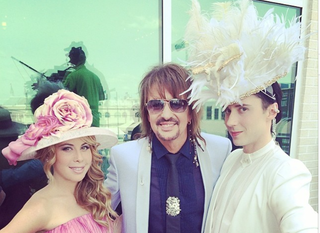 Illustration for article titled Here is What Johnny Weir is Wearing Right Now at the Kentucky Derby