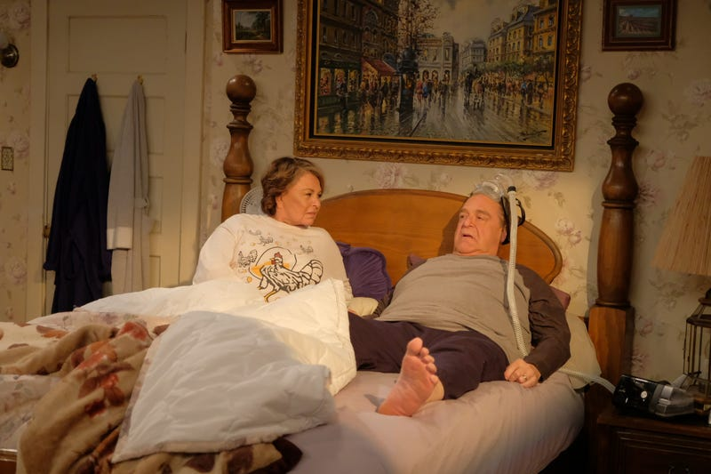 Roseanne Barr (left) and John Goodman wake up after 20 years off the air