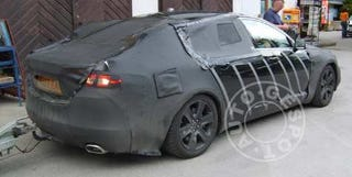 Illustration for article titled Spy Photos: New Jaguar XF To Get 500 Horsepower, Trailer Hitch