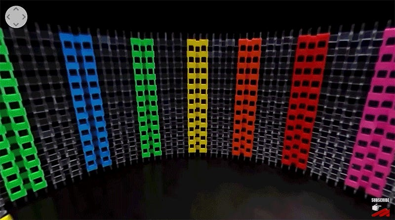 Dominoes News Videos Reviews And Gossip Gizmodo - Video dominoes falling reverse simply mesmerizing