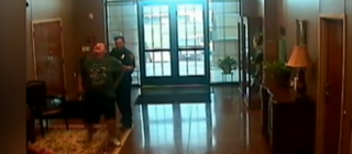 Video footage shows Rickey Joe Scott during his encounter with a police officer. Scott, a white man, says that after the officer asked for his ID, he repeatedly offered it, but that instead of accepting it, the officer pulled out a Taser and used it to zap Scott, who collapsed.Maynard Institute