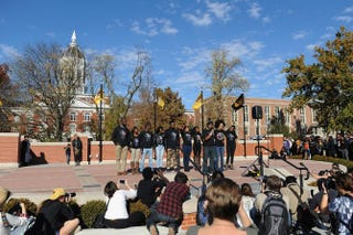 Members of the Concerned Student 1950 movement speak to a crowd of students on the campus of the University of Missouri in Columbia Nov. 9, 2015. Students celebrated the resignation of university President Tim Wolfe amid allegations of racism. Michael B. Thomas/Getty Images