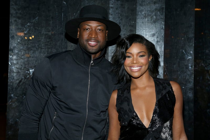 Gabrielle Union (R) and Dwyane Wade (L) during Spring 2016 New York Fashion Week: The Shows on September 13, 2015 in New York City.