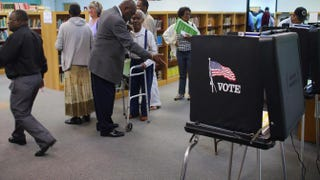 Voters prepare to cast their ballots on Nov. 1, 2012, in North Miami, Fla.Joe Raedle/Getty Images