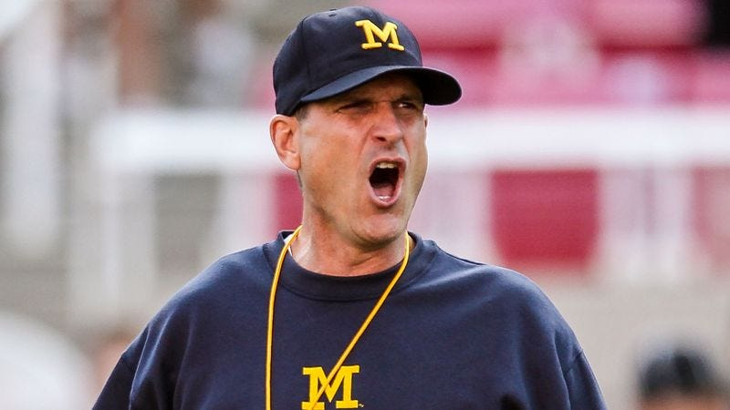 Illustration for article titled Wild-Eyed Jim Harbaugh Informs Players They Must Kill Their Pregame Meal