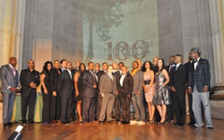 Some of The Root 100 honorees pose on stage with publisher Donna Byrd.