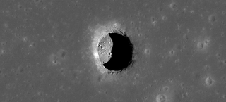 Illustration for article titled What's hiding behind these giant holes on the Moon?