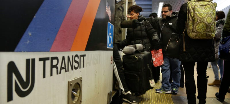 New Jersey Transit passengers board a train at Seacaucus Junction in Seacaucus, NJ. (AP Photo/Julie Jacobson)