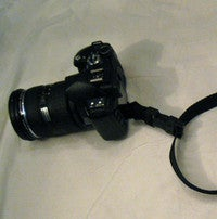 Illustration for article titled DIY Camera Sling Keeps Your DSLR at the Ready