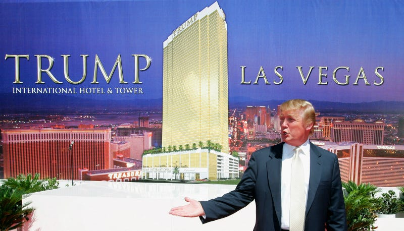 Trump poses after a ceremonial groundbreaking for the 64-story Trump International Hotel & Tower Las Vegas July 12, 2005 in Las Vegas, Nevada. Photo via Getty