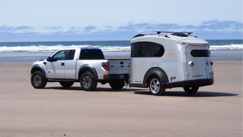 Illustration for article titled This Rare Compact Airstream Looks Boss With A Matching Ford Raptor