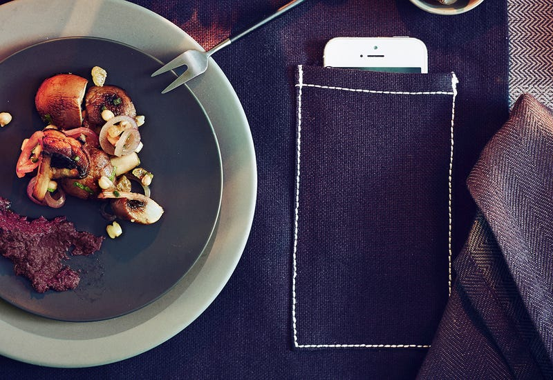 Illustration for article titled Ikea Promises Peaceful Meals By Adding Smartphone Pockets to Placemats
