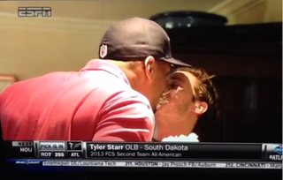 Illustration for article titled Here's NFL Draftee Michael Sam Kissing His Boyfriend Through Cake