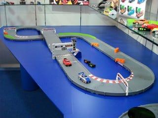 Illustration for article titled AI Tech Racers: Danger Dodging Slot Cars