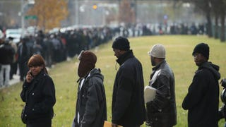 Job seekers wait in line at Chicago's Kennedy-King College to attend a job fair hosted by the city on Nov. 9, 2012.Scott Olson/Getty Images