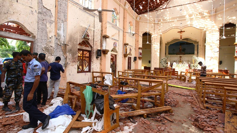Sri Lankan officials inspect St. Sebastian's Church in Negombo, north of Colombo, after multiple explosions targeting churches and hotels across Sri Lanka.