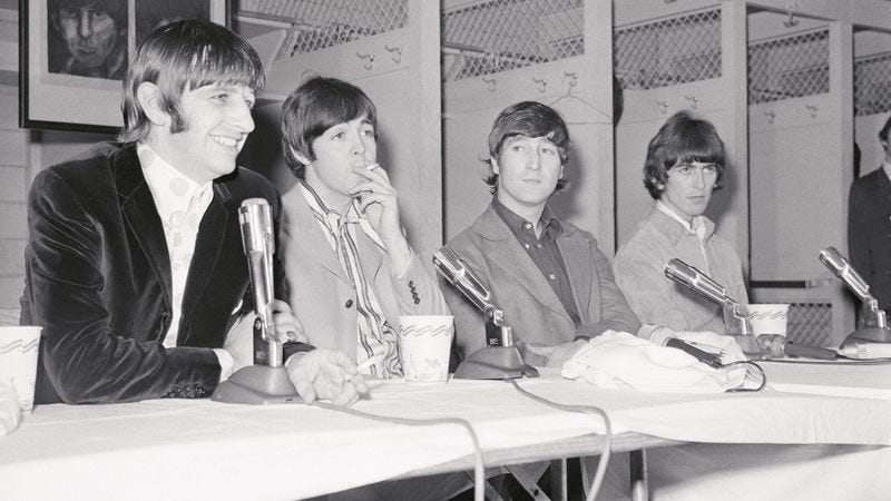 The Beatles meet with the press prior to their August 15, 1966 concert in Washington D.C. Not pictured: The Cyrkle, or the group of local teens posing as The Cyrkle. (Photo: Bettmann/Getty Images)