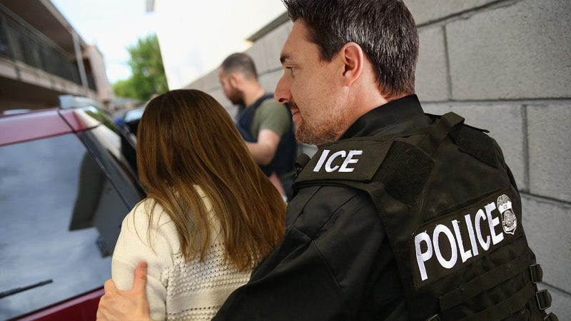 Illustration for article titled Thrilling: This ICE Officer Currently Escorting An Immigrant Woman Away From Her Family Is Thinking About Which Movie Star Would Play Him In A Film Called 'American Sentinel'