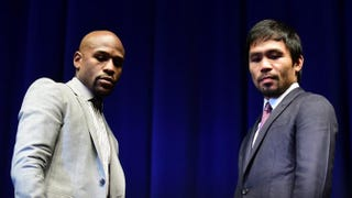 Floyd Mayweather Jr. and Manny Pacquiao pose during a press conference March 11, 2015, in Los Angeles. FREDERIC J. BROWN/AFP/Getty Images