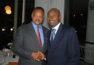 Alain Dolium (right) with the Rev. Jesse Jackson Sr.