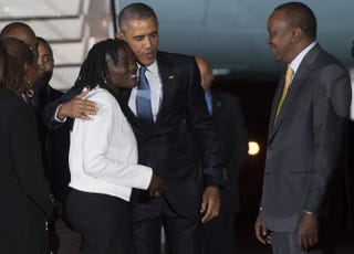 President Barack Obama (center) greets his half sister Auma Obama (left) while standing alongside Kenyan President Uhuru Kenyatta upon President Obama's arrival at Kenyatta International Airport in Nairobi July 24, 2015. It is Obama's first visit to the country of his father's birth since his election as president.SAUL LOEB/AFP/Getty Images
