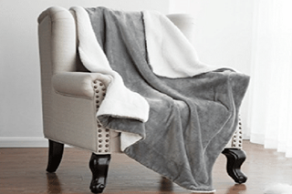 Illustration for article titled Use Decorative Sherpa Throw Blanket to Give Accent to Your Home