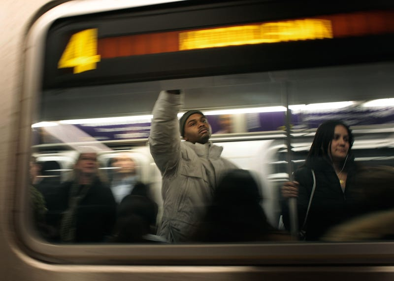 Riders stand on a subway train passing through Grand Central Station in New York City on March 25, 2009.Chris Hondros/Getty Images
